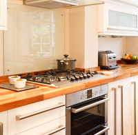 Kitchen with wooden work surfaces