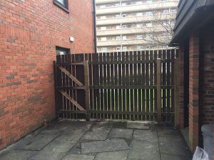 Repaired and re-erected fence from bin area
